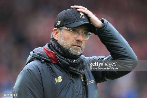 Liverpool manager Jurgen Klopp looks dejected as he adjusts his cap during the Premier League match between Liverpool and Chelsea at Anfield on April...