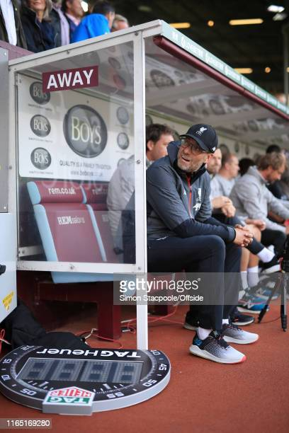 Liverpool manager Jurgen Klopp looks on from the dugout before the Premier League match between Burnley and Liverpool at Turf Moor on August 31, 2019...