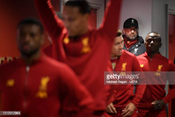 Liverpool manager Jurgen Klopp looks on in the tunnel as the teams line up before the UEFA Champions League round of 16 second leg match between...