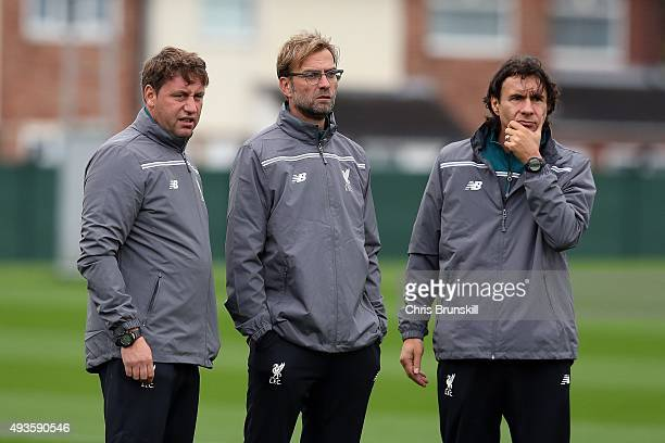 Liverpool manager Jurgen Klopp looks on next to his assistants Peter Krawietz and Zeljko Buvac during a Liverpool training session at Melwood...