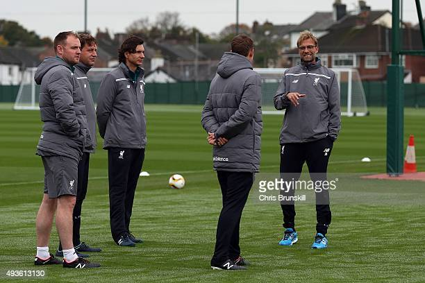 Liverpool manager Jurgen Klopp makes a point to his assistants during a Liverpool training session at Melwood Training Ground on October 21 2015 in...