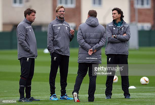 Liverpool manager Jurgen Klopp makes a point to his assistants Peter Krawietz and Zeljko Buvac during a Liverpool training session at Melwood...