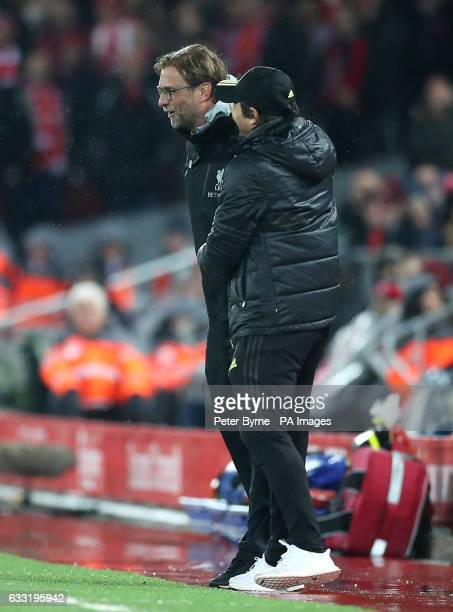 Liverpool manager Jurgen Klopp shares a joke with Chelsea manager Antonio Conte on the touchline during the Premier League match at the Anfield...