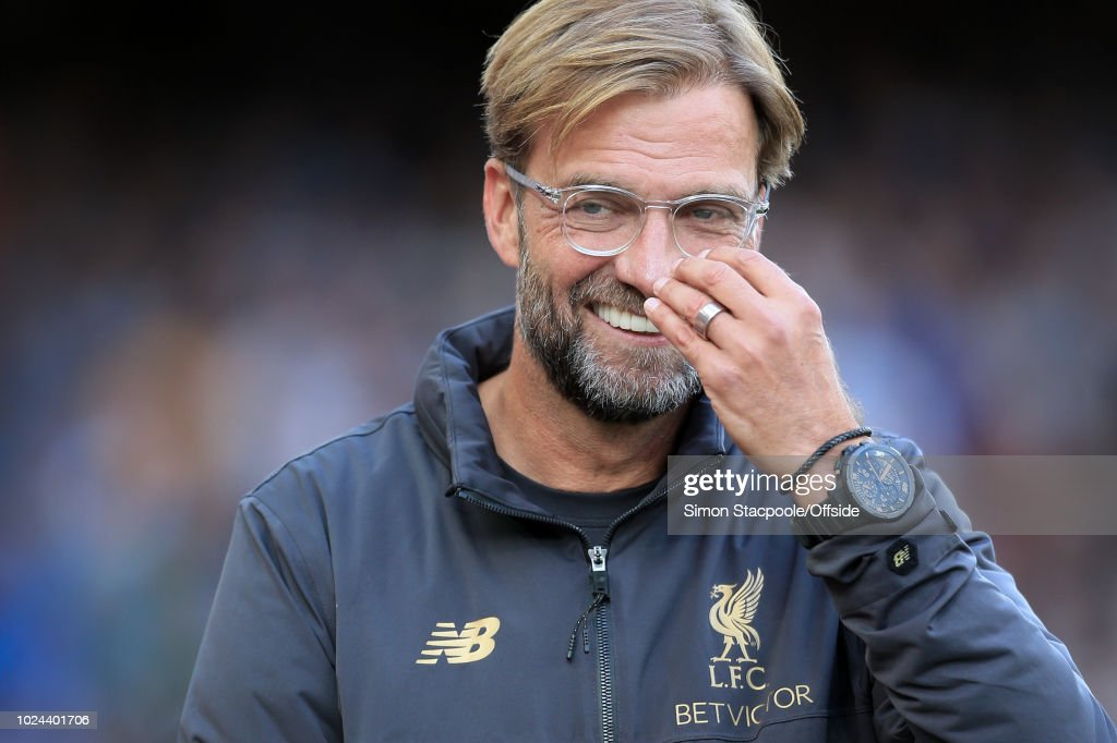 Liverpool manager Jurgen Klopp smiles during the Premier League match between Liverpool and Brighton & Hove Albion at Anfield on August 25, 2018 in Liverpool, England.