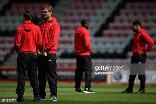 Liverpool manager Jurgen Klopp speaks with Adam Lallana ahead of the Barclays Premier League match between AFC Bournemouth and Liverpool at the...