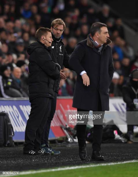 Liverpool manager Jurgen Klopp speaks with fourth official Michael Jones during the Premier League match between Swansea City and Liverpool at...