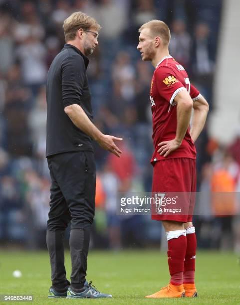 Liverpool manager Jurgen Klopp speaks with Ragnar Klavan after the Premier League match at The Hawthorns West Bromwich
