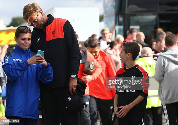 Liverpool manager Jurgen Klopp stops for a photograph as he arrives for a PreSeason Friendly match between Tranmere Rovers and Liverpool at Prenton...