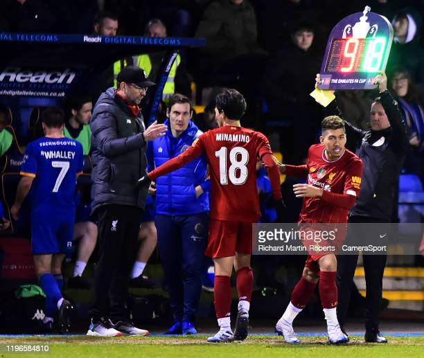 Liverpool manager Jurgen Klopp substitutes Takumi Minamino for Liverpool's Roberto Firmino during the FA Cup Fourth Round match between Shrewsbury...