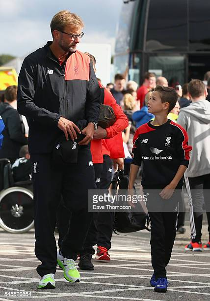 Liverpool manager Jurgen Klopp talks to a young fan as he arrives for a PreSeason Friendly match between Tranmere Rovers and Liverpool at Prenton...