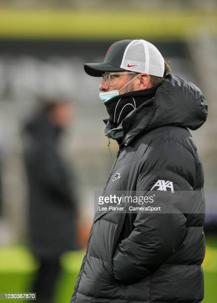 Liverpool manager Jurgen Klopp wearing a surgical mask and Liverpool baseball cap during the Premier League match between Newcastle United and...