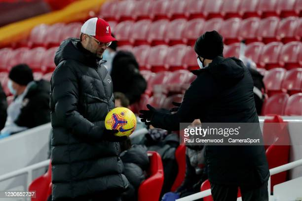 Liverpool manager Jurgen Klopp with the match ball during the Premier League match between Liverpool and Manchester United at Anfield on January 17,...