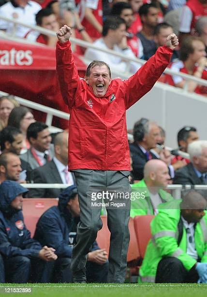 Liverpool manager Kenny Dalglish celebrates victory after the Barclays Premier League match between Arsenal and Liverpool at the Emirates Stadium on...