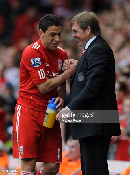 Liverpool manager Kenny Dalglish congratulates Maxi Rodriguez on his performance during the Barclays Premier League match between Liverpool and...