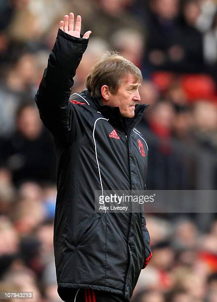 Liverpool Manager Kenny Dalglish salutes the fans prior to the FA Cup sponsored by E.ON 3rd round match between Manchester United and Liverpool at...