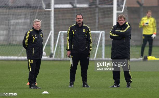 Liverpool manager Kenny Dalglish with assitant manager Steve Clarke and coach Sammy Lee during a training session ahead of their UEFA Europa League...