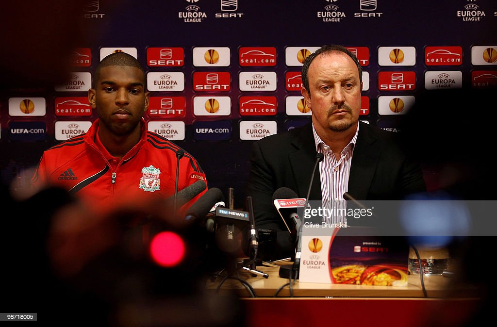 Liverpool manager Rafael Benitez and Ryan Babel of Liverpool listen to a question whilst being filmed during the press conference prior to the UEFA Europa League semi final second leg match between Liverpool and Athletico Madrid at Anfield on April 28, 2010 in Liverpool, England.