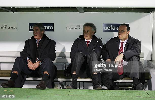 Liverpool Manager Rafael Benitez Chief Executive Rick Parry and Club Chairman David Moores watch from the dugout prior to the UEFA Champions League...
