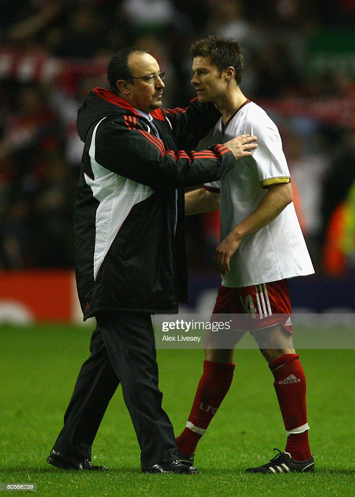 Liverpool Manager Rafael Benitez congratulates Xabi Alonso of Liverpool at the end of the UEFA Champions League Quarter Final, second leg match between Liverpool and Arsenal at Anfield on April 8, 2008 in Liverpool, England.