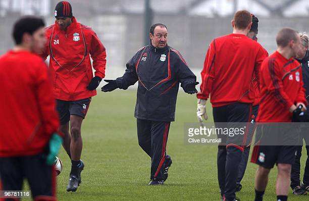 Liverpool manager Rafael Benitez speaks to his players during a training session prior to the UEFA Europa League round of 32 firstleg match between...