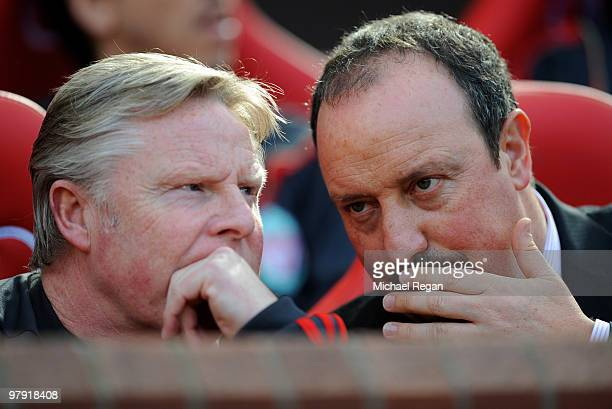 Liverpool manager Rafael Benitez talks to his assistant Sammy Lee during the Barclays Premier League match between Manchester United and Liverpool at...