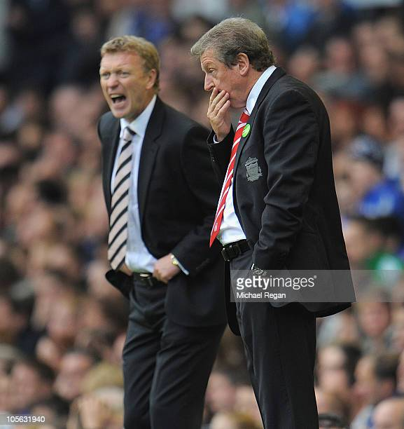 Liverpool manager Roy Hodgson looks dejected alongside Everton manager David Moyes during the Barclays Premier League match between Everton and...