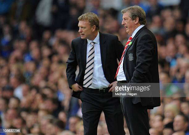 Liverpool manager Roy Hodgson looks on alongside Everton manager David Moyes during the Barclays Premier League match between Everton and Liverpool...