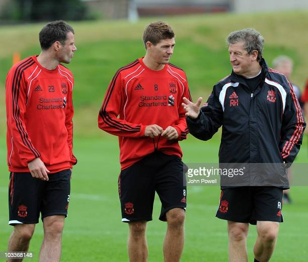 Liverpool manager Roy Hodgson speaks to captain Steven Gerrard and Jamie Carragher during a training session at Melwood training ground on August 13,...