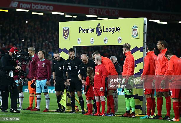 Liverpool mascots and players shake hands with the officials ahead the Premier League match between Liverpool and West Ham United at Anfield on...