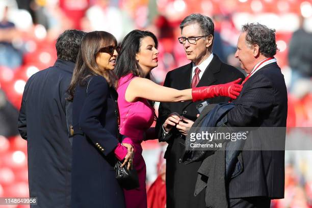 Liverpool owner John W Henry and his wife Linda Pizzuti look on from the pitch after the Premier League match between Liverpool FC and Wolverhampton...