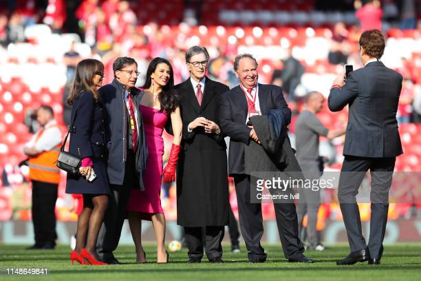 Liverpool owner John W. Henry and his wife, Linda Pizzuti pose for a picture on the pitch after the Premier League match between Liverpool FC and...