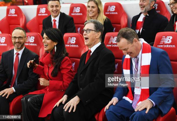 Liverpool owner John W. Henry and wife, Linda Pizzuti sit on the bench prior to the Premier League match between Liverpool FC and Huddersfield Town...