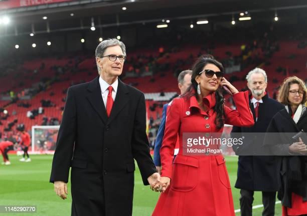 Liverpool owner John W. Henry and wife, Linda Pizzuti walk on the pitch prior to the Premier League match between Liverpool FC and Huddersfield Town...