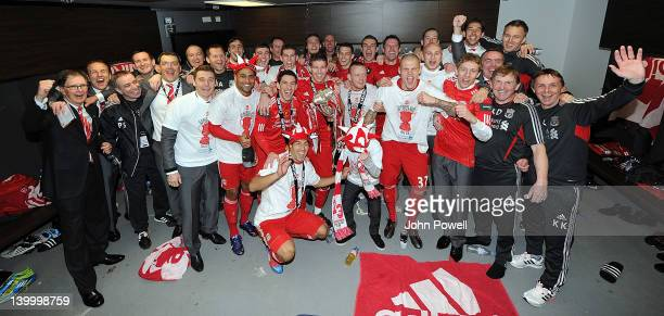 Liverpool owner John W Henry celebrates with the winning Liverpool team after the Carling Cup Final match between Liverpool and Cardiff City at...