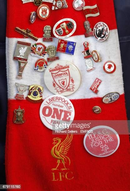 Liverpool pin badges on a scarf