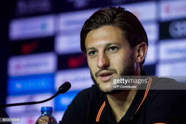 Liverpool player Adam Lallana speaks during a press conference of the Premier League Asia Trophy football tournament in Hong Kong on July 21 2017...