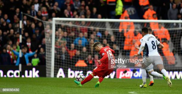 Liverpool player Alberto Moreno misses an open goal from just inside the West Brom half during the Premier League match between West Bromwich Albion...