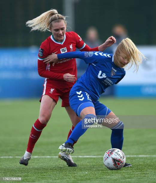 Liverpool player Ameilie Thestrup is held off in the challenge by Durham player Ellie Christon during the Barclays FA Women's Championship match...