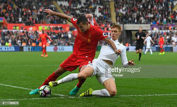 Liverpool player Dejan Lovren is challenged by Jay Fulton of Swansea during the Premier League match between Swansea City and Liverpool at Liberty...