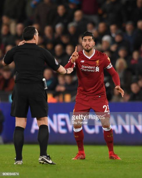 Liverpool player Emre Can reacts to Referee Neil Swarbrick during the Premier League match between Swansea City and Liverpool at Liberty Stadium on...
