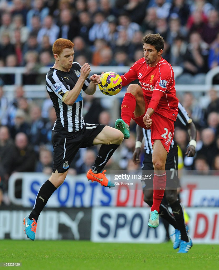 Liverpool player Fabio Borini (r) challenges Jack Colback during the Barclays Premier League match between Newcastle United and Liverpool at St James' Park on November 1, 2014 in Newcastle upon Tyne, England.