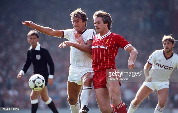 Liverpool player Jan Molby is challenged by Billy Bonds of West Ham as Geoff Pike looks on during the First Division match between the two sides at...