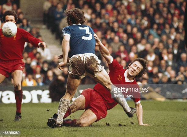 Liverpool player Jimmy Case puts in a hard tackle on Everton full back Mike Pejic during an FA Cup semi final match played at Maine Road on April 23...
