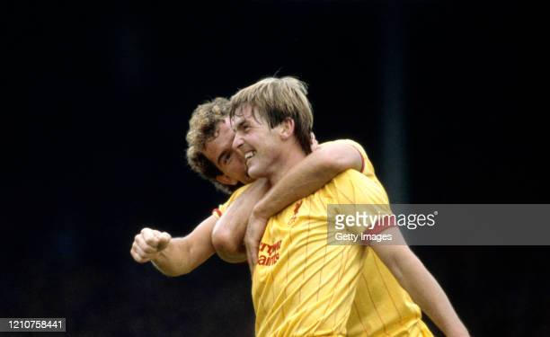 Liverpool player Kenny Dalglish is congratulated by Graeme Souness after scoring in a First Division match against Arsenal at Highbury on September...