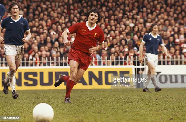 Liverpool player Kevin Keegan in action as Everton defenders Mike Lyons and Mike Pejic look on during an FA Cup semi final match played at Maine Road...