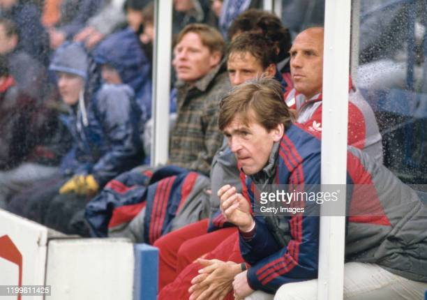Liverpool player manager Kenny Dalglish looks on from the bench with from left to right, Sammy Lee, Paul Walsh and trainer Ronnie Moran during a...