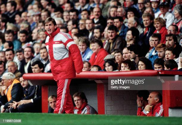 Liverpool player manager Kenny Dalglish wearing a long Adidas jacket shouts from the touchline as Steve McMahon and Steve Staunton look on from the...