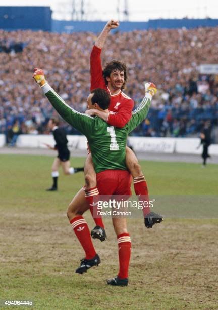 Liverpool player Mark Lawrenson celebrates with goalkeeper Bruce Grobbelaar after Liverpool had won the League Championship after the Division One...