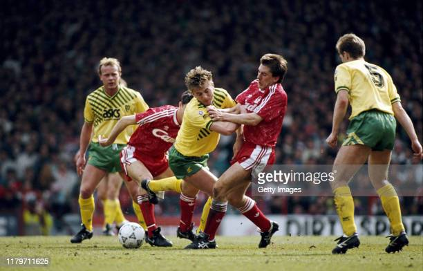 Liverpool player Peter Beardsley is challenged by Tim Sherwood of Norwich as Jeremy Goss of Norwich looks on during a First Division match at Anfield...
