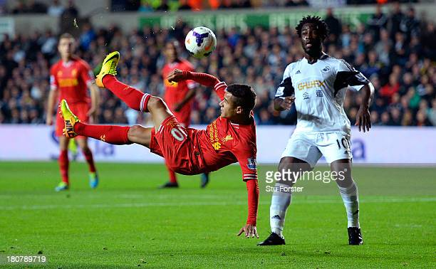 Liverpool player Phillipe Coutinho trys an overhead kick watched by Wilfried Bony of Swansea during the Barclays Premier League match between Swansea...